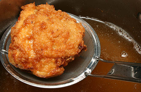 Almost finished piece of fried chicken